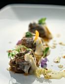 Snails confit with onions, black radish cream