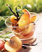 Peaches poached in banyuls with spices