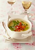 Thai soup with coconut milk, coriander and poultry