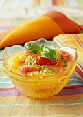 Citrus fruit salad with orange juice and basil