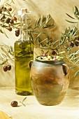 Bottle of olive oil and jar of olives
