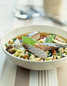 Penne and fish soup