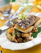 Piece of bass with old-fashioned vegetables