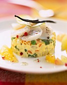 Vegetable timbal with scallops, citrus fruit and vanilla