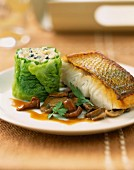 Bass steak with cabbage and truffle sushi