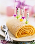Apricot jam Swiss roll with candles