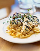 Grilled swordfish with onions and thyme