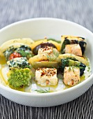 Assorted fish and green vegetable brochettes
