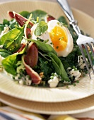 Rocket salad with a soft-boiled egg and smoked duck fillets