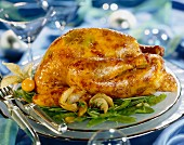 Roast capon garnished with truffles and served with spicy sugar peas