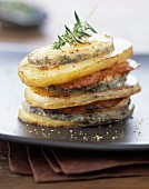 Potato, bacon and goat's cheese layer