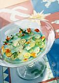 Citrus fruit soup with blue curacao