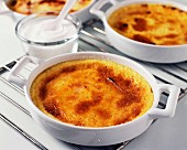 Taking the creme brulée out of the oven