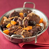 Stewed pork with prunes and carrots