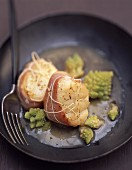 Monkfish wrapped in bacon with romanesco broccoli