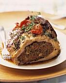 Thick round fillet of lamb stuffed à la provençale