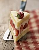 Slice of strawberry cream cake
