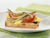 tomato bread with fried sand lance and celery salad
