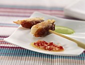 Scampi skewer with two sauces
