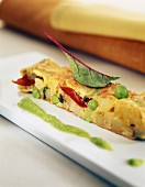 Vegetable omelet with peas and tomatoes