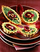 individual spinach and pine nut tarts
