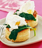 Puff pastry case filled with poached eggs and spinach