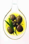 Olives in spoonful of oil