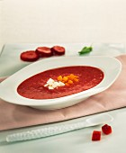 strawberry soup with diced pumpkin and fresh cheese