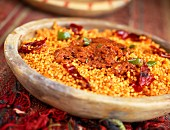 red and green bell pepper boulghour with harissa sauce