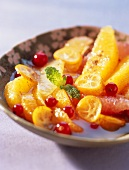 citrus fruit salad with syrup and fresh mint (topic: citrus fruit)