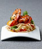 Linguine pasta with prawns and black sesame seeds