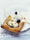 Goat cheese and blueberry puff-pastry tartlets