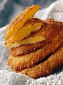 Sliced mango covered in coconut and deep fried