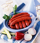 Raw merguez sausages