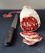 Dried sausage and knife
