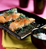 Pieces of salmon with dill cooked on one side a la plancha