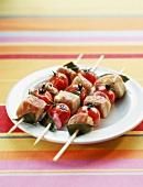 Pork and cherry tomato brochettes a la plancha