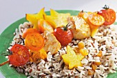 Chicken and curry brochettes with exotic fruits