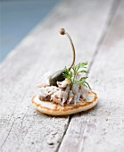 Mini blini with potted mackerel and capers