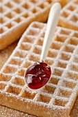 Waffle with icing sugar and jam