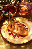 An apple turnover with fruits of the forest coulis