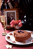 Heart-shaped chocolate cake and champagne for St Valentine's Day