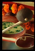 Soup and orange carnations