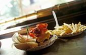 A hamburger and fries on a bar