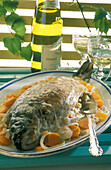 Carp stuffed with muscadet and its carrots