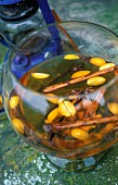 An aperitif with rum, spices and kumquats