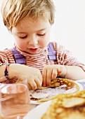 A little girl with a crêpe
