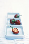 Chilli peppers on square plates