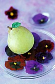 A pear and pansies