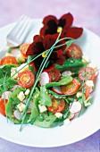 Spinach shoot, radish and pansy salad